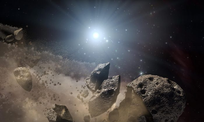 An asteroid breaks up in this artist's concept. (NASA)