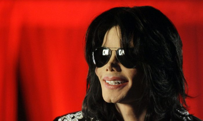 """In this March 5, 2009 file photo, Michael Jackson speaks at a news conference in London. AEG Live LLC CEO Randy Phillips told a jury Wednesday June 12, 2013 that they have heard an inaccurate portrait of Jackson during an ongoing civil trial, and said the entertainer was a sophisticated businessman and not a """"drug-addled 5-year-old."""" The company and Phillips are being sued by Jackson's mother, claiming they did not properly investigate the doctor convicted of causing her son's death in 2009. (AP Photo/Joel Ryan, File)"""
