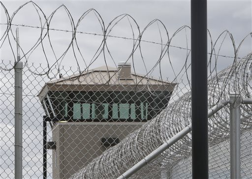 A guard tower looms over the fence surrounding the new California Correctional Health Care Facility in Stockton, Calif., Tuesday. (AP Photo/Rich Pedroncelli)