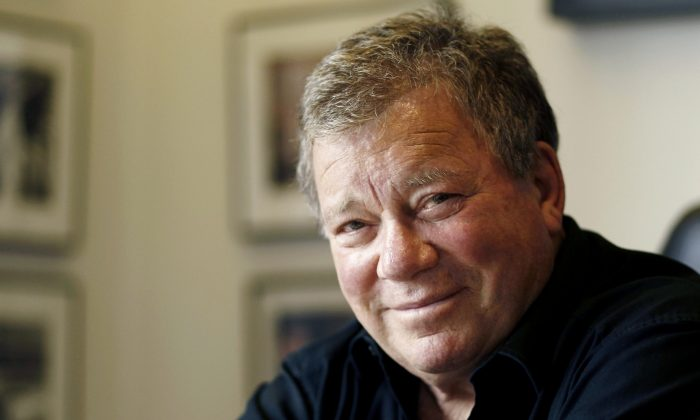 "A file photo of actor William Shatner in Los Angeles on Jan. 30, 2012. Shatner will guest star in a live episode of ""Hot in Cleveland,"" on Wednesday, June 19, 2013 airing on the TV Land channel. (AP Photo/Matt Sayles, file)"