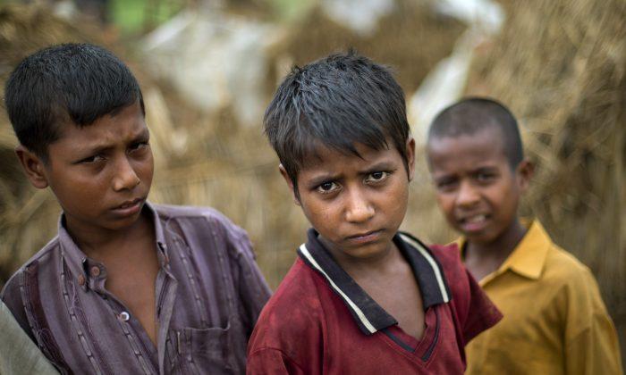 Internally displaced Rohingya boys in a camp for displaced Rohingya people in Sittwe, northwestern Rakhine State, Burma, May 15, 2013. (AP Photo/Gemunu Amarasinghe)