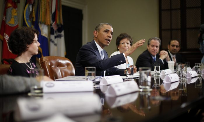 Valerie Jarrett is seen sitting to the left of former President Barack Obama in a file photo. (Pablo Martinez Monsivais/AP Photo)
