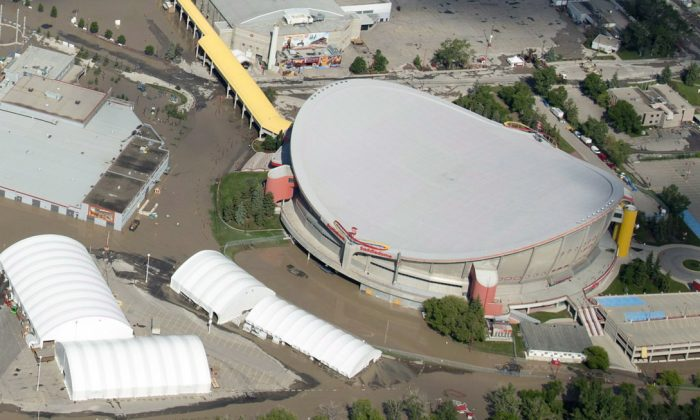 "An aerial view shows a flooded Calgary Saddledome on June 22, 2013. With floods receding, Calgary Stampede officials say the famed rodeo and festival will start as scheduled on July 5 ""come hell or high water."" A mandatory evacuation for High River residents remained in effect Wednesday. (THE CANADIAN PRESS/Jonathan Hayward)"