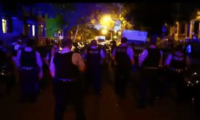 A screenshot of a Chicago Tribune-made YouTube video shows a strong police presence on S. Springfield Ave. after a shooting over the weekend.