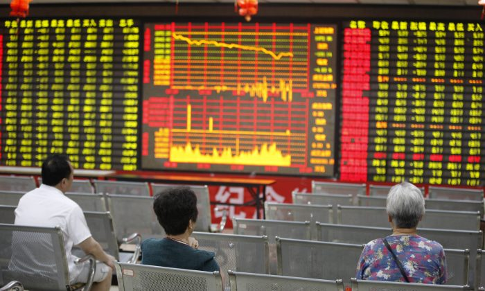 Investors watch the electronic board at a stock exchange hall on June 24, 2013 in Huaibei City, Anhui Province, China. The Shanghai Composite Index dropped 5.3 percent on Monday, triggering concern over the health of the Chinese economy. (ChinaFotoPress/Getty Images)