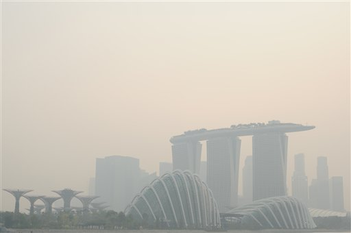 The Singapore skyline is shrouded in haze Friday, June 21, 2013. Air pollution in Singapore soared to record heights for a third consecutive day, as citizens become desperate to see the end of the smoky haze in three countries. (AP Photo/Joseph Nair)