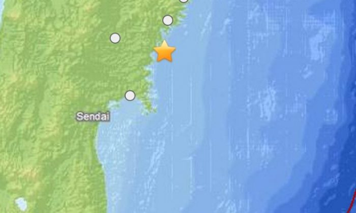 A screenshot of the USGS website shows where the earthquake struck off the coast of Japan.