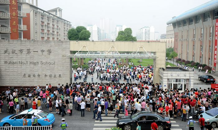 Chinese students arrive for the first day of the Gaokao in Wuhan on June 7, 2012. New security checks to prevent cheating mean female students in Jilin Province cannot wear underwire bras during China's upcoming college entrance exams. (STR/AFP/GettyImages)
