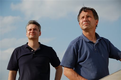 This undated photo provided by The Discovery Channel shows Carl Young, left, and Tim Samaras watching the sky. Jim Samaras said Sunday, June 2, 2013, that his brother storm chaser Tim Samaras was killed along with Tim's son, Paul Samaras, and another chaser, Carl Young,  on Friday, May 31, 2013 in Oklahoma City. The men were remembered for their courage and dedication to researching tornadoes. ( AP Photo/Discovery Channel)