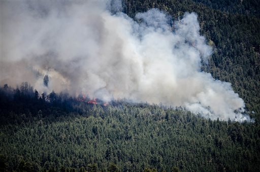 The Thompson Ridge fire burns in an area just north of the town of Jemez Springs, New Mexico, Saturday, June 1, 2013. Fire crews in New Mexico on Saturday fought two growing wild blazes that have scorched thousands of acres, spurred evacuation calls for dozens of homes and poured smoke into the touristy state capital. (AP Photo/The Albuquerque Journal, Roberto E. Rosales)