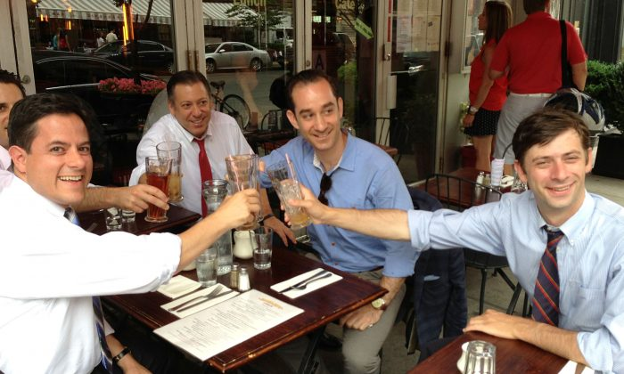 Council members Dan Garodnick (L) and Steve Levin (R) toast ice coffees at Edward's Cafe in Lower Manhattan to celebrate the imminent passage of a bill that would allow sidewalk cafes in New York City to open at 10 a.m. on Sundays. (Ivan Pentchoukov/Epoch Times)
