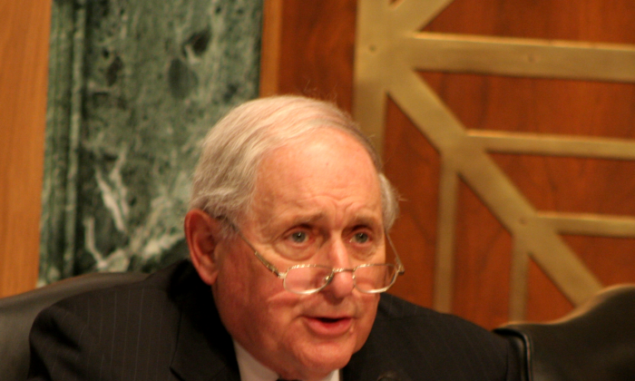 """U.S. Senator Carl Levin (D-Mich.) made a guest appearance June 25 at a hearing of the Congressional-Executive Commission on China (CECC) on """"Chinese Hacking"""" to promote his bill S.884, """"Deter Cyber Theft Act."""" The bill would prevent goods made with U.S. technology or proprietary information from entering the United States. (Gary Feuerberg/Epoch Times)"""