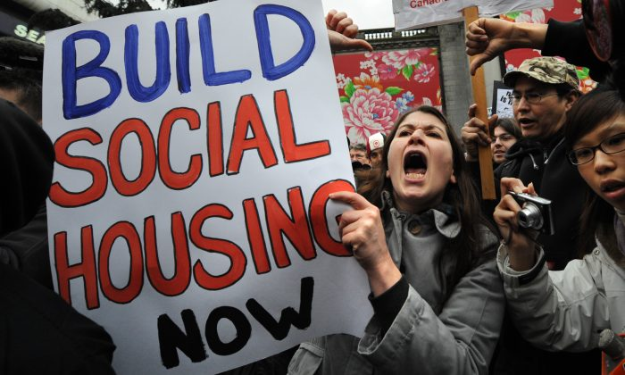People shout slogans for affordable housing at an anti-Olympics rally in Vancouver on February 12, 2010. Mayors from 22 of Canada's largest cities and a national cooperative housing organization are calling on the federal government to do more to address the country's low-income housing shortage. (YURI KADOBNOV/AFP/Getty Images)