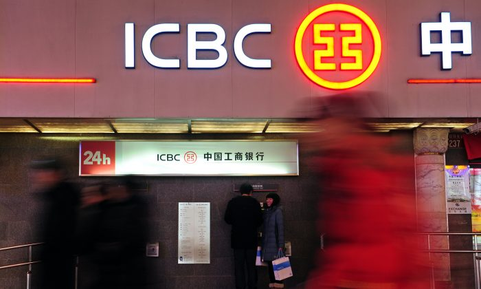 Customers use an automated teller machine at a branch of the Industrial and Commercial Bank of China in Beijing, China, on Jan. 29, 2011. (Frederic J. Brown/AFP/Getty Images)