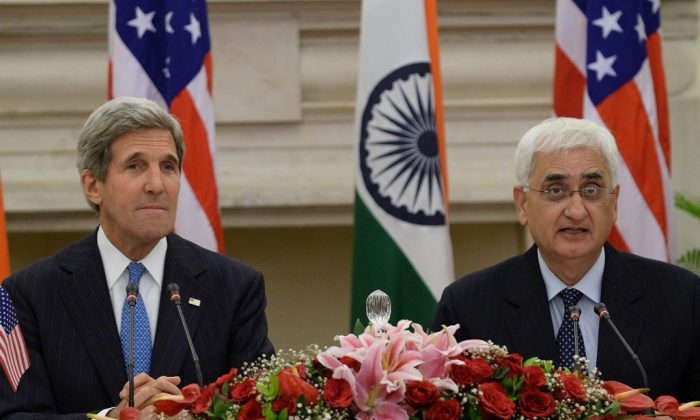 US Secretary of State John Kerry (L) and Indian External Affairs Minister Salman Khurshid address a joint press conference in New Delhi on June 24, 2013. US Vice President Joe Biden will travel to India next month in what will be the highest-level visit by an American official for three years, Secretary of State John Kerry said on a trip to New Delhi June 24, 2013. (Prakash Singh/AFP/Getty Images)