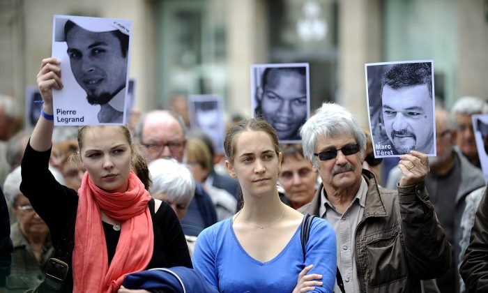 People gather to support four French hostages being held in Mali, kidnapped by Al-Qaeda in the Islamic Maghreb (AQMI) three years ago, in Nantes, France on June 1. France and other G-8 countries made an agreement June 18 not to pay ransom to terrorists. (Jean-Sebastien Evrard/AFP/Getty Images)