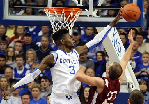 In this Nov. 5, 2012 file photo, Kentucky's Nerlens Noel (3) blocks the shot of Transylvania's Ethan Spurlin during the second half of an NCAA college basketball exhibition game at Rupp Arena in Lexington, Ky. Noel is a possible first round pick in the NBA Draft on June 27, 2013. (AP Photo/James Crisp, File)