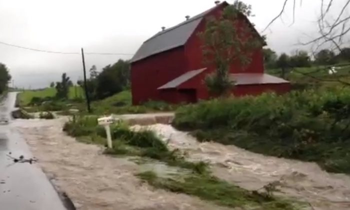 A screenshot of YouTube shows recent flooding in Otsego County in New York.