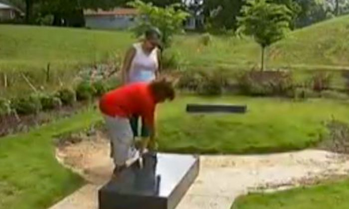 A monument to Michelle Obama's ancestor in Rex, Ga., knocked over. (Screenshot/WSB-TV)