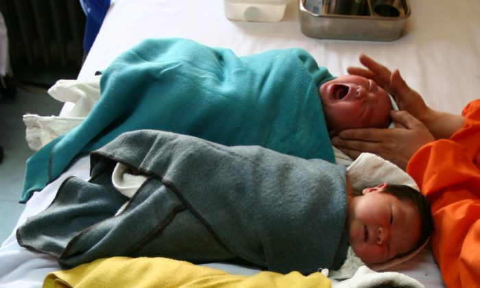 A nurse massages babies at the Xining Children Hospital in Xining City, Qinghai Province. Hospitals in Henan Province have been advertising the selling of unwanted babies, according to a report by China National Radio. (Getty Images)