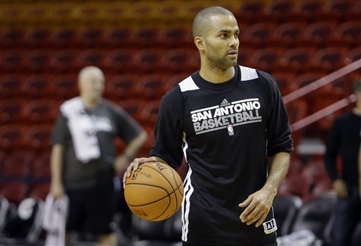 San Antonio Spurs' Tony Parker, of France, does drills during NBA basketball practice, Wednesday, June 5, 2013 in Miami. The Spurs play the Miami Heat in Game 1 of the NBA Finals Thursday. (AP Photo/Lynne Sladky)