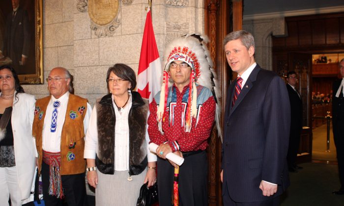 Prime Minister Stephen Harper poses with then-AFN National Chief Phil Fontaine before delivering a formal apology on behalf of the federal government and all Canadians to former students of Indian Residential Schools on June 11, 2008. Despite great hopes for change, AFN Chief Shawn Atleo says relations between the government and First Nations haven't improved. (Mike Carroccetto/Getty Images)