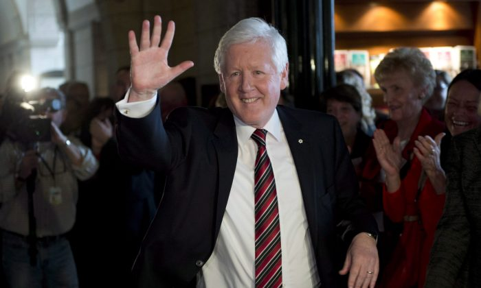 Liberal MP Bob Rae waves as he is greeted by party staff and MPs following his final caucus meeting as leader on Parliament Hill on March 27, 2013 in Ottawa. Rae, former interim Liberal leader and one-time NDP premier of Ontario, is resigning as an MP, winding up a political career that stretched over 35 years and two parties. (THE CANADIAN PRESS/Adrian Wyld)