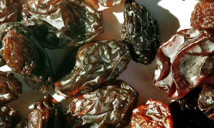 California produces nearly all the nation's raisins, and almost half the world's. But according to a 1937 agriculture law, farmers have to give as much as half their crop to the government without compensation. (Tim Boyle/Getty Images)