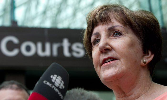 Former RCMP officer Valerie MacLean, one of the hundreds of current and former female Mounties who have come forward to join a class-action lawsuit alleging harassment and gender-based discrimination against the force, speaks to reporters outside British Columbia Supreme Court in Vancouver after the first hearing in the suit on August 2, 2012. (THE CANADIAN PRESS/Darryl Dyck)