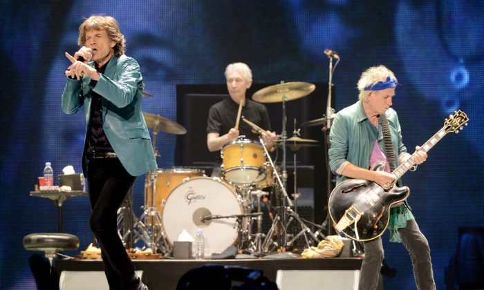 Singer Mick Jagger, musicians Charlie Watts and Keith Richards of The Rolling Stones perform at The Honda Center on May 15, 2013 in Anaheim, California as part of their latest tour. (Kevin Winter/Getty Images)