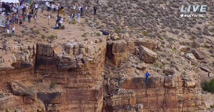 Nik Wallenda crossing a ravine in the Grand Canyon on a tightrope on June 23, 2013. Wallenda didn't wear a tether for his daring attempt, and if he had fallen the drop would have been about 1,400 feet. He completed the walk successfully. (Screenshot/Discovery Channel)
