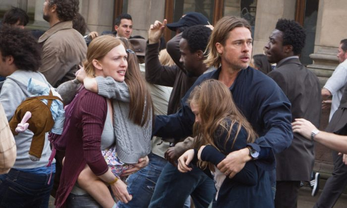 A scene from the zombie film, World War Z, starring Brad Pitt (center R) and Mireille Enos (center L). The film is adapted from a novel, which features a plot about the black market organ trade in China as the means for the zombie virus spreading. (Paramount Pictures)