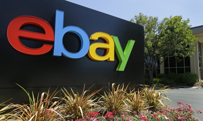 This Tuesday, July 16, 2013, photo shows an eBay sign at eBay headquarters in San Jose, Calif. (AP Photo/Ben Margot)