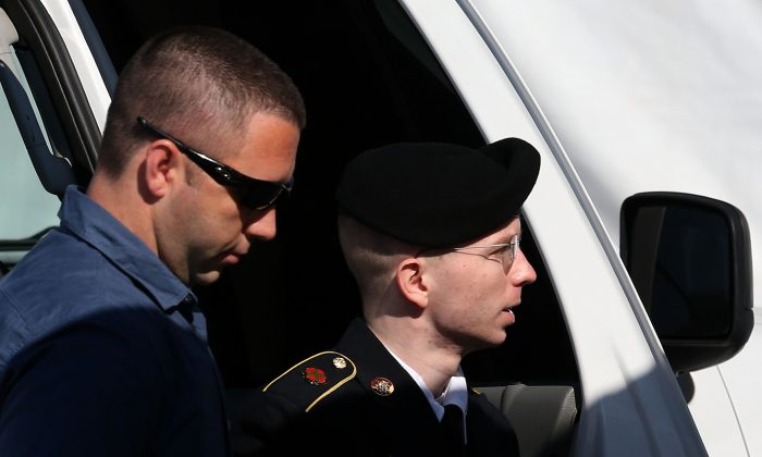 U.S. Army Private First Class Bradley Manning (R) is escorted by military police at Fort George G. Meade, Maryland on July 30, 2013. (Mark Wilson/Getty Images)