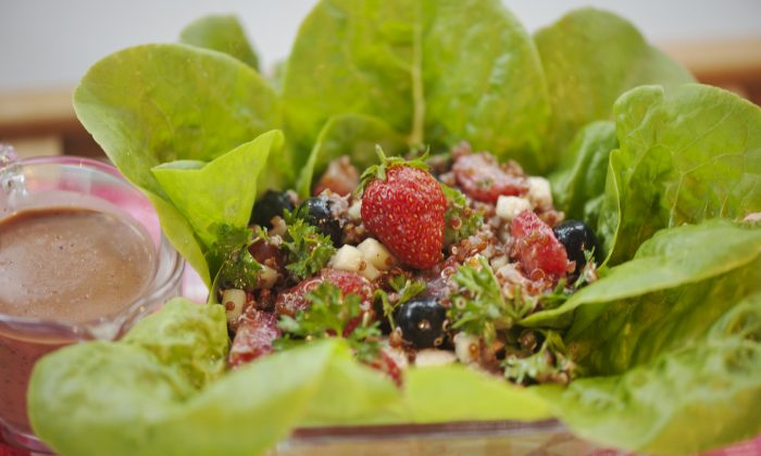 A colourful berry quinoa salad in a head of leafy lettuce. (Cat Rooney/Epoch Times)