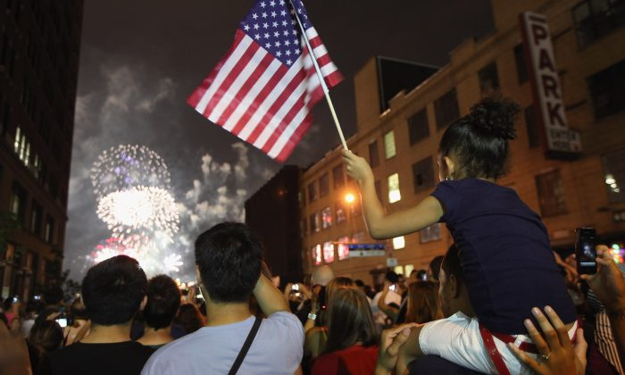 Revelers watch the fireworks display along the Hudson River from Manhattan on July 4, 2012 in New York City. Fireworks and cookouts need precautions. (Mario Tama/Getty Images)
