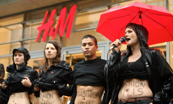 Young activists from the labor rights group ver.di demonstrate against working conditions at production sites used by the H&M clothing chain in Bangladesh on July 14, 2012 in Berlin, Germany. Bangladesh announced new workplace laws on July 15, 2013. (Adam Berry/Getty Images)