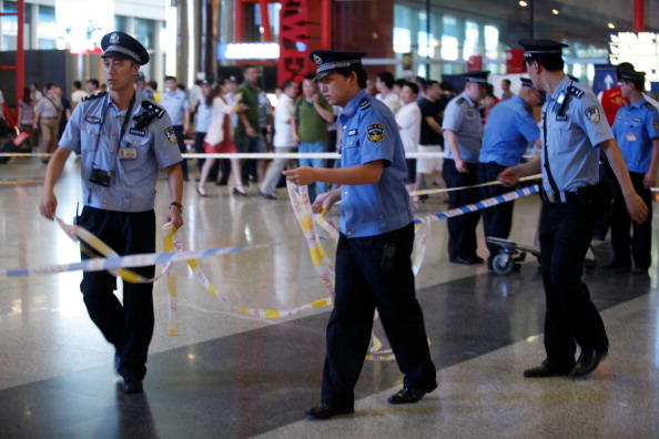 Policemen and security personnel secure Terminal 3 of the Beijing Capital International Airport where an explosion occurred on July 20, 2013 in Beijng, China. Disabled Ji tried to go through the court system to get justice, but no one would help him, so he set off a bomb. (ChinaFotoPress via Getty Images)
