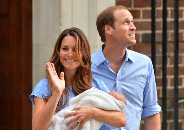 Prince William and Catherine, Duchess of Cambridge show their new-born baby boy to the world's media, on the steps outside the Lindo Wing of St Mary's Hospital in London on July 23, 2013. The baby was born on Monday afternoon weighing eight pounds six ounces (3.8 kilogrammes). The baby, titled His Royal Highness, Prince (name) of Cambridge, is directly in line to inherit the throne after Charles, Queen Elizabeth II's eldest son and heir, and his eldest son William.  (BEN STANSALL/AFP/Getty Images)