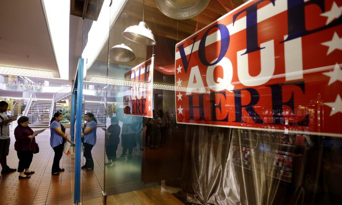 Voters wait in line at a polling place located inside a shopping mall on Election Day, in Austin, Texas on Nov. 6, 2012. (Eric Gay/AP Photo)