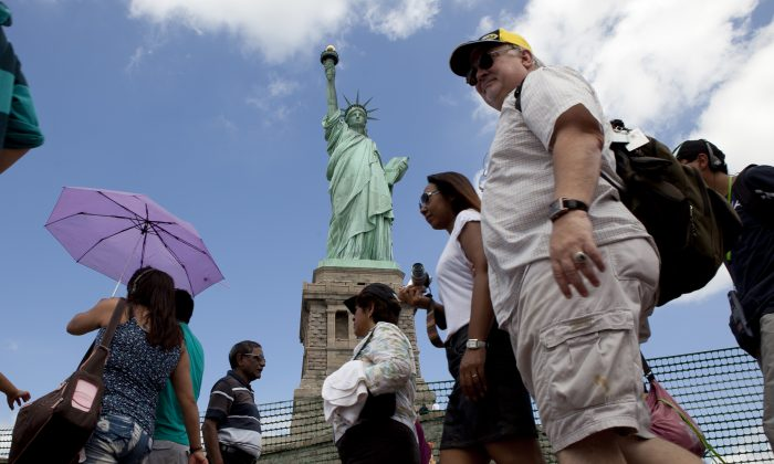 Tourists on Liberty Island on July 4, 2013. (Samira Bouaou/Epoch Times)