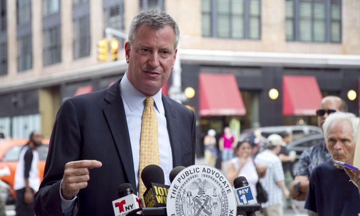 New York City Public Advocate Bill de Blasion speaks to the press on the corner of West 26th Street and 7th Avenue in Manhattan on July 23, 2013. De Blasio called on Anthony Weiner to resign from the mayoral race amid new allegations that Weiner sent inappropriate photographs to a woman. (Ivan Pentchoukov/Epoch Times)