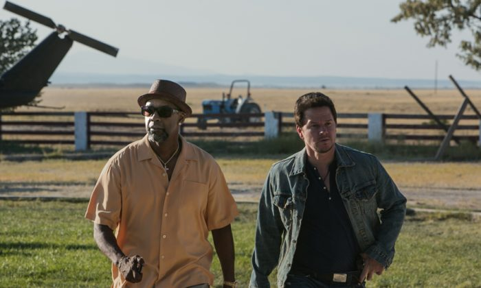 "Denzel Washington (L) and Mark Wahlberg (R) in the action-comedy ""2 Guns."" The film tracks two operatives from competing bureaus forced to be on the run together, yet both don't know the other is an undercover federal agent. (Patti Perret/Universal Studios)"