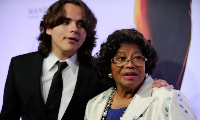 "Prince Jackson, left, and Katherine Jackson arrive at the world premiere of ""Michael Jackson ONE"" on June 29, 2013. (David Becker/Invision/AP, File)"
