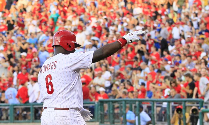 Philadelphia Phillies' Ryan Howard gestures towards the fans after hitting a solo home run during the third inning of a baseball game with the Atlanta Braves, Friday, July 5, 2013, in Philadelphia. The Phillies won 5-4. (AP Photo/Tom Mihalek)
