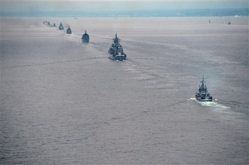 Russian Pacific Navy ships sail near the Sakhalin Island during military exercises on Tuesday, July 16, 2013. The maneuvers in Siberia and the far eastern region involved 160,000 troops and about 5,000 tanks - a massive show of force unprecedented since the Soviet times. (AP Photo/RIA Novosti, Alexei Nikolsky, Presidential Press Service)