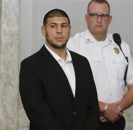 Former New England Patriots NFL football tight end Aaron Hernandez appears during a probable cause hearing at Attleboro District Court, on Wednesday, July 24, 2013, in Attleboro, Mass. Hernandez has pleaded not guilty to murder in the death of Odin Lloyd, a 27-year-old Boston semi-professional football player whose body was found June 17 in an industrial park in North Attleboro near Hernandez's home. (AP Photo/Bizuayehu Tesfaye)