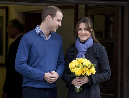 Prince William stands next to his wife Kate, Duchess of Cambridge, in December (AP Photo/Alastair Grant, File)