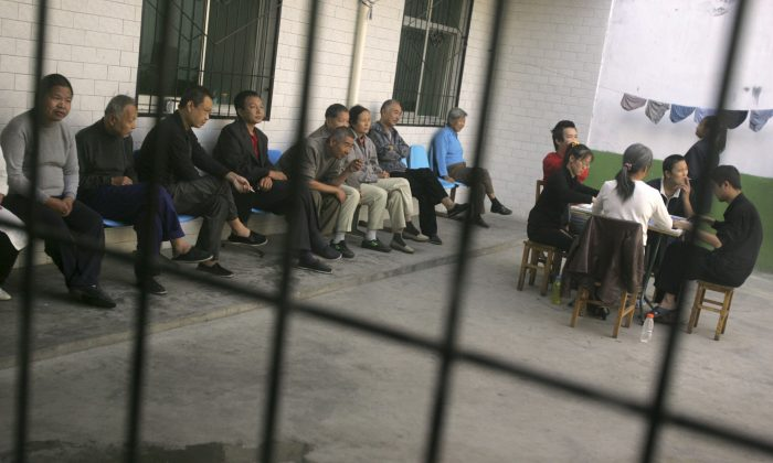 In this file photo mental patients are seen inside a hospital in Xian in Shaanxi Province, China, on Oct. 8, 2006. Reports of sane people being forced into mental hospitals in China after complaining to authorities are increasing.(China Photos/Getty Images)