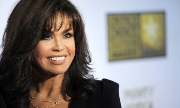 """This June 10, 2013 file photo shows TV host Marie Osmond at the Critics' Choice Television Awards in Beverly Hills, Calif. Hallmark Channel announced that they are canceling Osmonds' show """"Marie."""" (Photo by Chris Pizzello/Invision/AP, File)"""